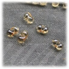 cba00044-2x4 about 2 x 4 mm, transparent, yellowish hue, czech seed beads, 25 g.