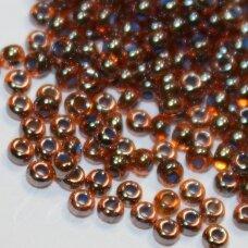 pccb91004-10/0 2.2 - 2.4 mm, apvali forma, skaidrus, ruda spalva, blizgi danga, viduriukas mėlyna spalva, apie 50 g.