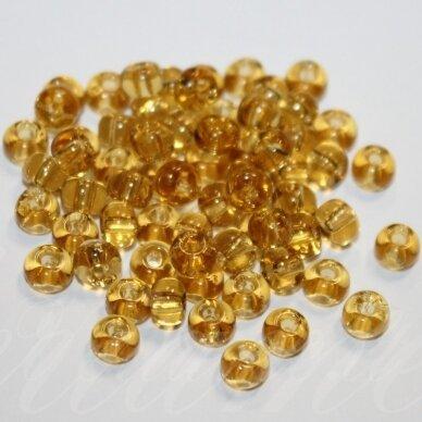 pccb10020-13/0 1.6 - 1.8 mm, apvali forma, skaidrus, geltona spalva, apie 50 g.