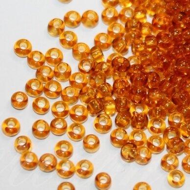pccb10070-13/0 1.6 - 1.8 mm, apvali forma, skaidrus, gintaro spalva, apie 50 g.