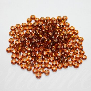 pccb29001/17070-06 3.7 - 4.3 mm mm, apvali forma, skaidrus, šviesi, ruda spalva, viduriukas su folija, ab danga, kvadratinė skylė, apie 50 g.